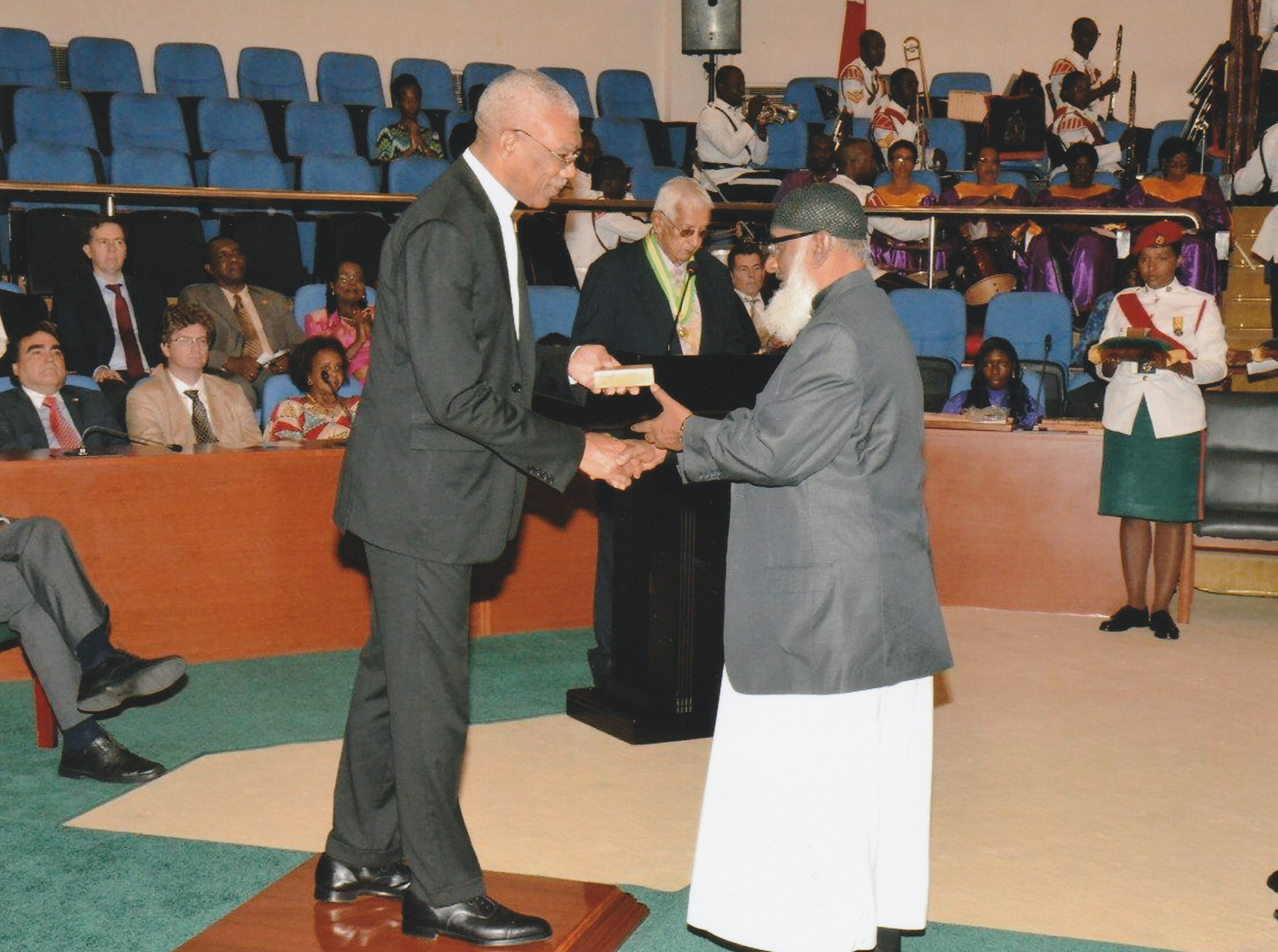 Br. Mujay receives Medal of Service Award from H. E President Granger